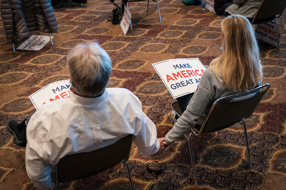 "DULUTH, MN – SEPTEMBER 9: Two supporters hold hands while listening to Donald Trump, Jr.'s ""Make America Great Again"" rally in Duluth, Minnesota on Wednesday, Sept. 9, 2020."