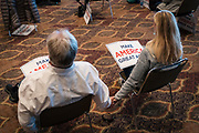 """DULUTH, MN – SEPTEMBER 9: Two supporters hold hands while listening to Donald Trump, Jr.'s """"Make America Great Again"""" rally in Duluth, Minnesota on Wednesday, Sept. 9, 2020."""