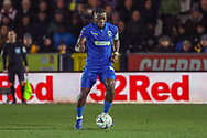 AFC Wimbledon defender Deji Oshilaja (4) dribbling during the The FA Cup match between AFC Wimbledon and West Ham United at the Cherry Red Records Stadium, Kingston, England on 26 January 2019.
