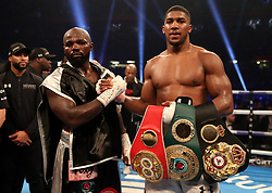 Anthony Joshua celebrates victory over Carlos Takam after the IBF World Heavyweight Title, IBO World Heavyweight Title and WBA Super World Heavyweight Title bout at the Principality Stadium, Cardiff.
