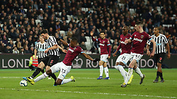 West Ham United's Issa Diop challenges Newcastle United's Fabian Schar during the Premier League match at London Stadium.