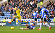 Leeds United Midfielder Lewis Cook skips past Sheffield Wednesday Forward Fernando Forestieri during the Sky Bet Championship match between Sheffield Wednesday and Leeds United at Hillsborough, Sheffield, England on 16 January 2016. Photo by Adam Rivers.