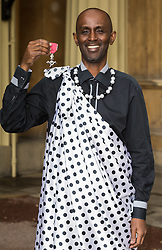 Eric Murangwa displays his MBE for services to Raising Awareness of the Rwandan Genocide,  awarded by The Queen at an investiture ceremony at Buckingham Palace. London, March 15 2018.