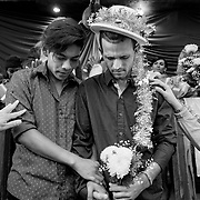 A couple is married at a ceremony in Tijuana outside of a shelter offering temporary housing. LGBTQ migrants sought refuge in the shelter out of fear of being singled out and persecuted. Along with thousands of other migrants, they traveled nearly a month before arriving in Tijuana, Mexico. The migrants planned to ask for asylum while presenting themselves to authorities at the US Port of Entry at San Ysidro, CA and hoped that their marriage would keep them from being separated.