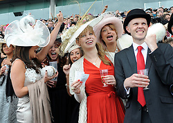 © licensed to London News Pictures. ASCOT, UK.  16/06/11. People celebrate whilst watching a race. Ladies Day at Royal Ascot 16 June 2011. Royal Ascot has established itself as a national institution and the centrepiece of the British social calendar as well as being a stage for the best racehorses in the world. Mandatory Credit Stephen Simpson/LNP