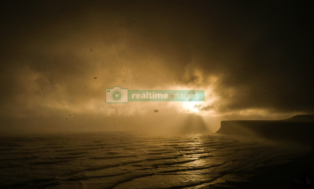 April 26, 2017 - Saltburn-By-The-Sea, North Yorkshire, England - Saltburn-By-The-Sea, UK.  ..An ethereal light from the morning sun shines through storm clouds and sleet over Huntcliff in Saltburn-By-The-Sea as unseasonably cold Arctic weather sweeps across the country. (Credit Image: © Ian Forsyth/London News Pictures via ZUMA Wire)