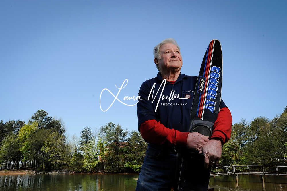 20120412 Donnie Oehler built his log cabin from a kit on the Lake Norman property that's been in his family since 1963. For his 60th birthday he waterskied standing on his head on a circular board. His 70th is this May 28th, Memorial Day weekend. <br /> www.lauramuellerphotography.com<br /> photo by Laura Mueller