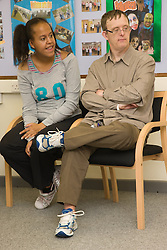 Boyfriend and girlfriend day service users with learning disabilities sitting together,