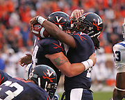 Virginia quarterback Jameel Sewell (10), right, celebrates a touchdown with teammate Virginia center Jack Shields (64) during an ACC football game Saturday in Charlottesville, VA. Duke won 28-17. Photo/Andrew Shurtleff