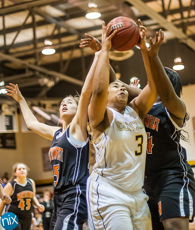 Concord's Jada Black pulls down a rebound against Northwest Cabarrus Tuesday night at Concord High School. Northwest Cabarrus won the game 38-21.