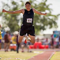 """051014       Cable Hoover<br /> <br /> Chinle Wildcat Wyatt Tuni jumps for 44'11"""" in the triple jump during the Arizona State Track Meet at Mesa Community College Saturday."""