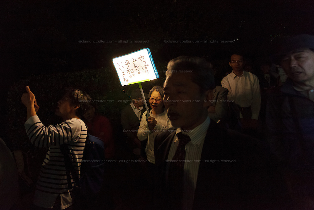 """Older anti war protestors take part in a demo  lead by teenagers against against the Hawkish administration of Prime Minister, Shinzo Abe, outside the National Diet building in Nagatacho, Tokyo, Japan. Friday June 3rd 2016. Teenagers of the protest group T-nsSOWL called for the right wing Abe to step down and reverse his planned changes to the """"Peace Constitution"""" of Japan which would allow the Japanese armed forces to undertake military activities outside Japan for the first time since the World War 2."""