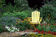 63821-14018 Yellow Adirondack chair in flower garden  Marion Co IL