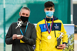 Vid Batolin and his coach with best athlete trophy at Slovenian Indoor Championship, Olympic centre Novo Mesto, 13 February 2021, Novo Mesto, Slovenia. Photo by Grega Valancic / Sportida