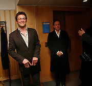 DOMINIC WEST AND GEORDIE GREIG. After-drinks JOSEPHINE HART Poetry Hour. British Library. Euston Rd. London. 22 March 2006. ONE TIME USE ONLY - DO NOT ARCHIVE  © Copyright Photograph by Dafydd Jones 66 Stockwell Park Rd. London SW9 0DA Tel 020 7733 0108 www.dafjones.com