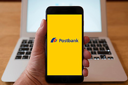 Using iPhone smart phone to display website logo of Postbank, German retail bank