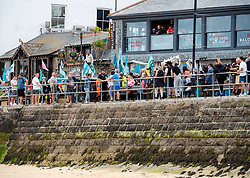 © Licensed to London News Pictures; 11/06/2021; St Ives, Cornwall UK. G7 summit in Cornwall. A protest by Extinction Rebellion processes along the sea front in St Ives on the first day of the G7 summit. Photo credit: Simon Chapman/LNP.