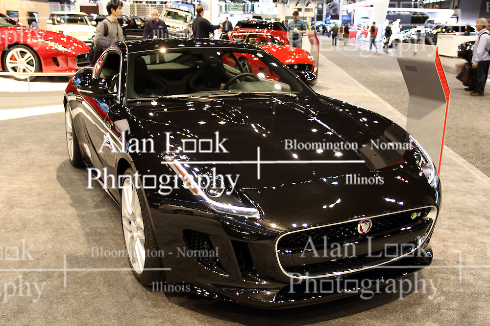 """12 February 2015:  2015 JAGUAR F-TYPE - Type R: Powerful, agile and distinctive, the 2015 Jaguar F-Type Coupe is a true Jaguar sports car, engineered for high performance and instantly responsive handling – the latest in a distinguished bloodline of cars. Supercharged engines, lightweight aluminum body construction and advanced driving technologies deliver an experience that is intuitive, instinctive and alive. There are three coupe variations in the F-Type range: F-Type, F-Type S and top-tier F-Type R.  Its 1+1 cockpit configuration wraps around the driver, sitting low in the heart of the F-TYPE, close to the center of gravity. While each F-Type trim level offers its own distinctive characteristics, all are equally at home on mountain switchbacks, on the highway or in the city. The Jaguar supercharged 3.0 liter V-6 340-horsepower engine delivers powerful and efficient performance. Compelling performance and beguiling design, the F-Type S Coupe adds a 380-hp supercharged 3.0L V-6 engine and a broader range of sophisticated driving technologies and up to 11.65 cubic feet of trunk space. It includes a limited-slip differential and Sport Suspension with Adaptive Dynamics. A panoramic glass roof is optional. The rear spoiler automatically deploys at 70-mph on Coupe models, reducing lift by up to 264-pounds for excellent high-speed stability. With a price of $100,000, the 2015 Jaguar F-Type R Coupe offers soaring performance, outstanding levels of dynamic capability and control. Its 5.0 liter supercharged V-8 engine produces 495-hp, accelerating from 0-60 mph in just 4.0-sec. The F-Type R features an Electronic Active Differential, Jaguar Super Performance Braking System, and Sport Suspension with Adaptive Dynamics. All powerplants come mated to an eight-speed """"QuickShift"""" ZF transmission with Sport mode. <br /> <br /> First staged in 1901, the Chicago Auto Show is the largest auto show in North America and has been held more times than any other auto exposition on the c"""