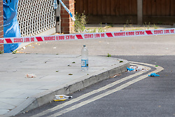 © Licensed to London News Pictures. 11/07/2019. London, UK. Medical gloves and bloodied bandages remain on the ground in Tellson Avenue, Greenwich where a man in his twenties was stabbed. Police were called at 1440hrs on Wednesday, 10 July to reports of a stabbing. The victim was taken to hospital where he died off his injuries. Photo credit: Peter Macdiarmid/LNP