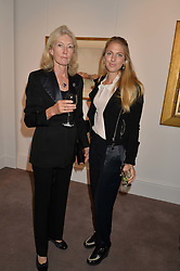 Left to right, JESSICA DICKINSON and her daughter PHOEBE DICKINSON at a reception to celebrate the publication of Hockney - A Pilgrim's Progress by Christopher Simon Sykes held at Sotheby's, New Bond Street, London on 30th September 2014.
