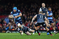 27th April 2019 , Principality Stadium , Cardiff, Wales ; Guinness pro 14's, Round 21, Cardiff Blues Vs Ospreys ; Olly Robinson of Cardiff Blues is tackled by Sam Davies of Ospreys<br /> <br /> Credit :  Craig Thomas/Replay Images