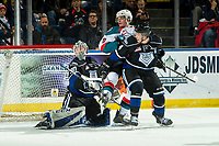 KELOWNA, CANADA - JANUARY 25:  Mark Liwiski #9 of the Kelowna Rockets is checked by Ralph Jarratt #4] in front of the net of Griffen Outhouse #30 of the Victoria Royals on January 25, 2019 at Prospera Place in Kelowna, British Columbia, Canada.  (Photo by Marissa Baecker/Shoot the Breeze)