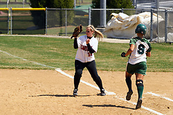 05 April 2008:  Jacquelyn Tassone reels in the throw to first that puts out Allison Ward. The Carthage College Lady Reds lost the first game of this double header to the Titans of Illinois Wesleyan 4-1 at Illinois Wesleyan in Bloomington, IL