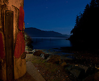 Lights on the wharf shine on the ocean surrounding Port Renfrew, located two hours' drive from Victoria, BC.
