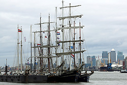 © Licensed to London News Pictures. 26/08/2015.  Tall ships at Woolwich. A number of tall ships have arrived in London today in rainy weather including the Chilean navy's four masted sail training ship Esmerelda. Other ships are heading to south east London for a tall ships event which is part of the Mayor of London's Totally Thames festival. Credit : Rob Powell/LNP