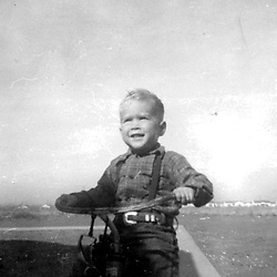 HS752   George W. Bush riding his tricycle, Odessa, TX, <br /> circa 1948.<br /> Photo Credit:  George Bush Presidential Library