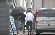 Exclusive<br /> <br /> a contestant arrives under umbrella in green jacket as friends remove suitcases at the hotel hideaway for Celebrity Big Brother which starts on Monday evening<br /> ©Exclusivepix