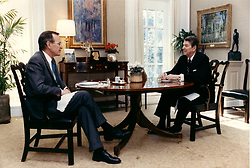 Washington, D.C. - February 10, 1988 -- United States President Ronald Reagan talks with Vice President George H.W. Bush over lunch on February 10, 1988 in the Oval Office Study at the White House in Washington, DC. Photo by White House/CNP/ABACAPRESS.COM