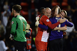 Orient players celebrate the win as Coventry City's Joe Murphy walks off dejected - Photo mandatory by-line: Mitchell Gunn/JMP - Tel: Mobile: 07966 386802 08/10/2013 - SPORT - FOOTBALL - Brisbane Road - Leyton - Leyton Orient V Coventry City - Johnstone Paint Trophy