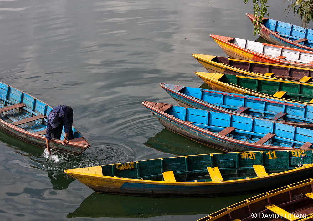 Colourful wooden boats on Phewa Lake, located in Pokhara Valley.