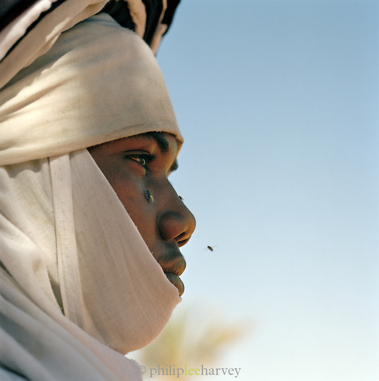 Profile of Tuareg Tribesman and flies, Libya