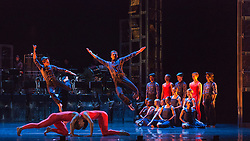"""© Licensed to London News Pictures. 12/05/2015. London, England. At the front Pierre Tappon and Luke Ahmet. Rambert Dance Company perform the World Premiere of """"Dark Arteries"""" by Mark Baldwin as part of a triple bill at Sadler's Wells Theatre. Rambert perform with the Tredegar Town Band and the Rambert Orchestra from 12 to 16 May 2015. Photo credit: Bettina Strenske/LNP"""