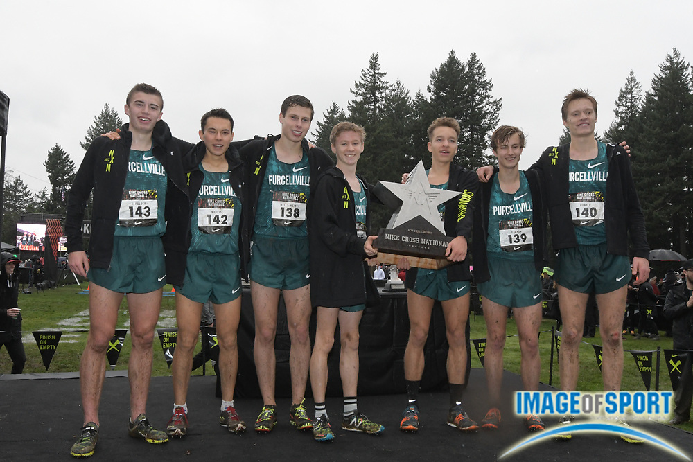 Dec 2, 2017; Portland, OR, USA; Members of the Purcellville boys' team pose with the championship trophy after winning the team title during the 2017 Nike Cross Nationals at Glendoveer Golf Course. Team members  include Sam Affolder (143), Peter Morris (142), Connor Wells-Weiner (138), Kevin Carlson (137), Colton Bogucki (141), Chase Dawson (139) and Jacob Hunter (140).