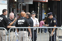 NEW YORK, Sept. 18, 2016 (Xinhua) -- Investigators are seen near the blast site in New York, U.S., Sept. 18, 2016. All 29 people wounded in Saturday's blast in New York City were released from hospitals, Mayor Bill de Blasio said Sunday at a news conference on the explosion. (Xinhua/Wang Ying) (Credit Image: © Wang Ying/Xinhua via ZUMA Wire)
