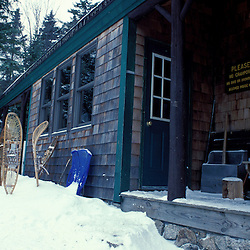 AMC Huts White Mountain N.F. The AMC's Zealand Hut adorned with snowshoes.  Winter.  Zealand Falls, NH