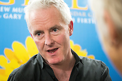 "© Licensed to London News Pictures . 12/01/2016 . Salford , UK . Writer TIM FIRTH backstage after making a surprise appearance at the Lowry Theatre ,  during the opening week of "" The Girls "" , a musical he wrote with Gary Barlow , based on the story "" Calendar Girls "" , about a group of Women's Institute members in Yorkshire , who made a nude calendar . Photo credit : Joel Goodman/LNP"