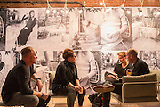 Fair visitors relax in the booth of Menu A/S, a Danish design company.