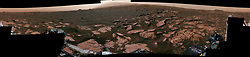 """May 5, 2017 - Space - This 360-degree mosaic from the Mast Camera (Mastcam) on NASA's Curiosity Mars rover looks out over a portion of the Bagnold Dunes, which stretch for several miles. From early February to early April 2017, the rover examined four sites near linear dunes for comparison with what it found in late 2015 and early 2016 during its investigation of crescent-shaped dunes. This two-phase campaign is the first close-up study of active dunes anywhere other than Earth. The dark, rippled surface of a linear dune is visible at the center of the view and receding into the distance to the left. The bedrock of the Murray formation, made from sediments deposited in lakes billions of years ago, is in the foreground, along with some components of the rover. The location, called """"Ogunquit Beach,"""" is on the northwestern flank of lower Mount Sharp. (Credit Image: © JPL-Caltech/MSSS/NASA via ZUMA Wire/ZUMAPRESS.com)"""