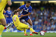 Ruben Loftus-Cheek of Chelsea is challenged by Luke James of Bristol Rovers. EFL Cup 2nd round match, Chelsea v Bristol Rovers at Stamford Bridge in London on Tuesday 23rd August 2016.<br /> pic by John Patrick Fletcher, Andrew Orchard sports photography.