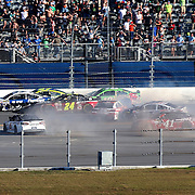 Sprint Cup Series driver Jeff Gordon (24) is involved in a crash on the backstretch during the final lap of the 57th Annual NASCAR Daytona 500 race at Daytona International Speedway on Sunday, February 22, 2015 in Daytona Beach, Florida.  (AP Photo/Alex Menendez)