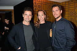 Left to right, LEO FENWICK, his sister MIA FENWICK and ADAM KELLY at a party to celebrate 10 years of footware designer Nicholas Kirkwood held at 9 Adam Street, London on 19th September 2015.