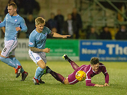 Forfar Athletic's Michael Travis brings down Arbroath's Michael McKenna for his second booking and a red card. Forfar Athletic 2 v 3 Arbroath, Scottish Football League Division One played 8/12/2018 at Forfar Athletic's home ground, Station Park, Forfar.