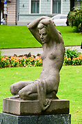 Stone statue of a naked young woman in Bastejkalna parks, Riga, Latvia