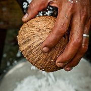 Local Man preparing coconut for a traditional meal.