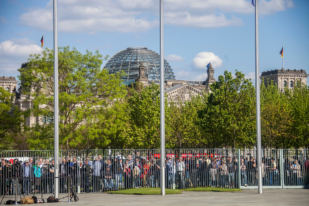Spectators gathered in front of the  chancellery in Berlin prior to a meeting of The German Chancellor Angela Merkel , and the French President Emmanuel Macron, as part of Macron first official visit as President to Germany, on  Monday, May 15, 2017. (Photo by Omer Messinger)