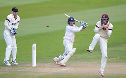 Hampshire's Liam Dawson hits the ball as Somerset's Tom Abell takes evasive action and Luke Ronchi looks on.  - Mandatory byline: Alex Davidson/JMP - 07966386802 - 12/09/2015 - CRICKET - The County Ground -Taunton,England - Somerset CCC v Hampshire CCC - Day 4